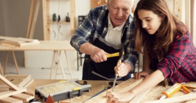 Grandpa with granddaughter enjoy  at grandpa's carpentry workshop
